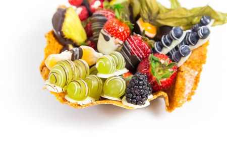 blanketed: Fitness dessert: fruit salad covered with decorative chocolate