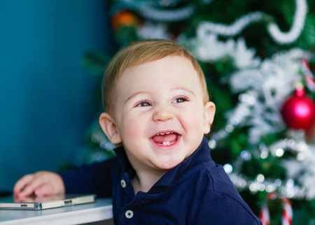 blonde baby portait - laughing baby