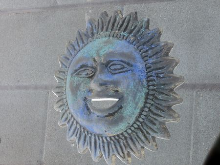 Negative sun with bright smiling face
