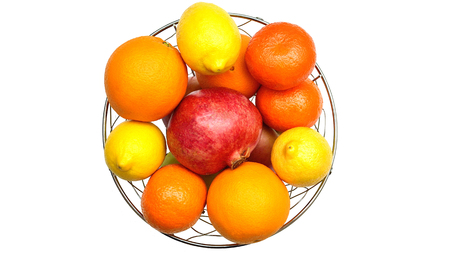 apples and oranges: apples, oranges, lemons, pomegranates, tangerines on a white background Stock Photo