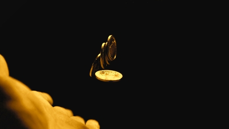Man holding coins in his hands