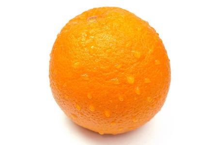 orange peel skin: orange with drops of water on the skin