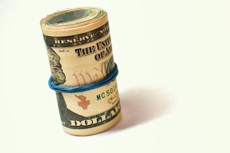 tightening: dollars isolated on white background. Stock Photo