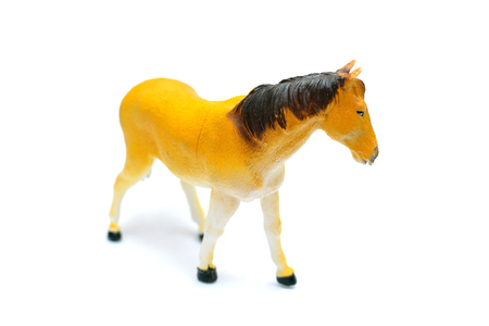 cultural artifacts: Rubber toy horse on white background Stock Photo
