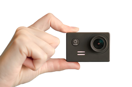 Action camera in hand. White background
