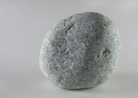Wild pebble stone isolated on white background. Jadeite stone. Reklamní fotografie