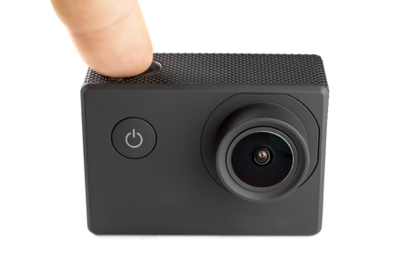 Action camera isolated on white background. Pushing the button