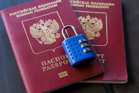 Two Russian passports locked to padlock. Symbol of anti-Russian sanctions. Reklamní fotografie