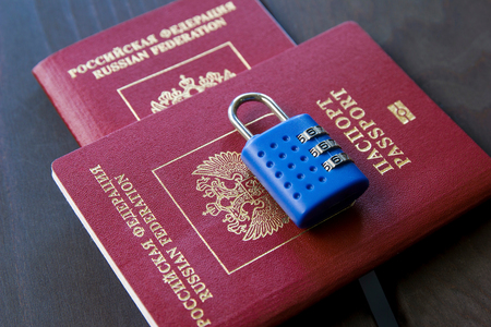 Symbol of anti-Russian sanctions. Two Russian passports locked to padlock. Reklamní fotografie