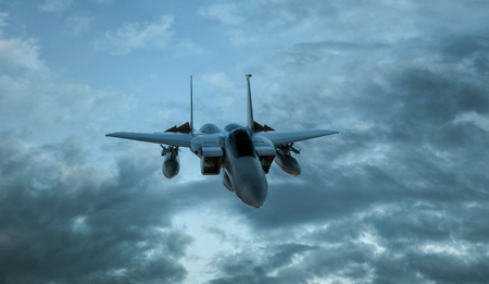 Armed military fighter jet in flight on the cloudly sky background - 3d render Reklamní fotografie