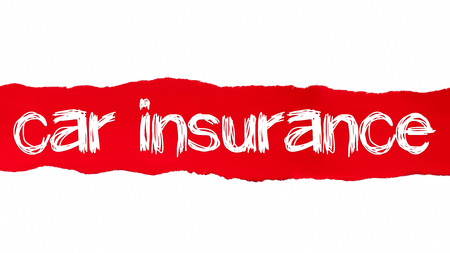 Torn paper with word car insurance. Stock Photo