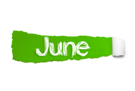 The word June appearing behind green torn paper