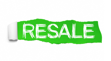 RESALE text, Inspiration, Motivation and Business concept on Green torn paper.