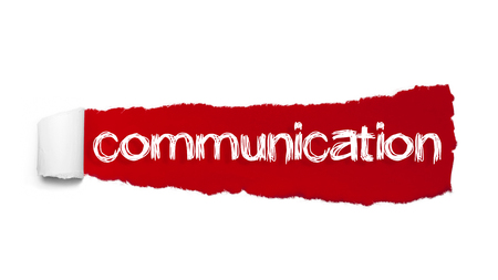 COMMUNICATION word written under the curled piece of Red torn paper. Stock Photo