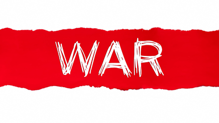 WAR word written under the curled piece of Red torn paper. Фото со стока