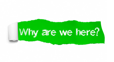 Why are we here, appearing behind green torn paper.