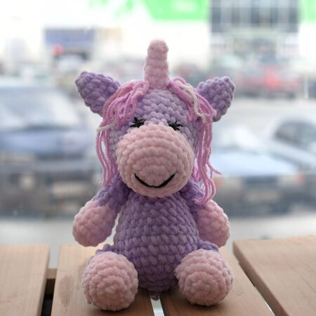 Crocheted amigurumi unicorn. Knitted handmade toy.