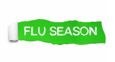 The text FLU SEASON written under the curled piece of Green torn paper. Stockfoto