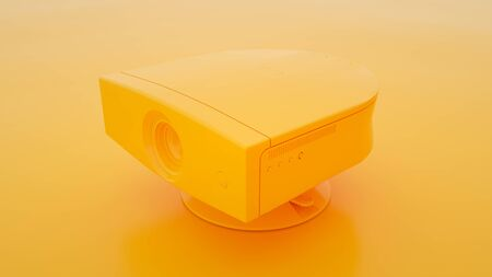 Multimedia Projector on yellow background. 3d illustration. Stock Photo