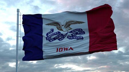 Flag of Iowa waving in the wind against deep beautiful clouds sky. 3d rendering.
