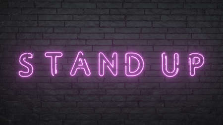 Stand Up neon sign. Glowing Stand Up emblem on black brick wall background. 3d rendering
