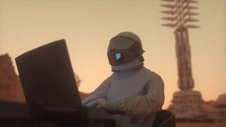 Astronaut in the space suit works on a laptop in a space colony on one of the planets. 3d rendering