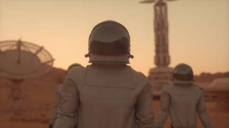 Three Astronauts in Space Suits Confidently Walking on Mars. Mars Colonization Concept. 3d rendering