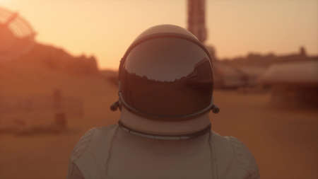 Astronaut on the planet Mars. Astronaut walking on the surface of Mars. Colonization concept. 3d rendering