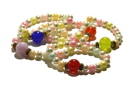 freshwater pearl: Pearl bracelets  Bracelets made of artificial pearls with large, colorful beads  Photo taken on a white background