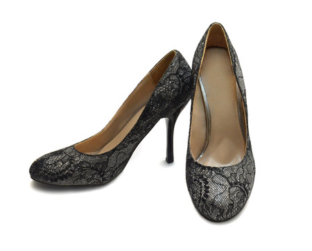 Shoes lining of guipure and brocade heels. Photo on a white background photo