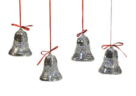 silver bells: Christmas ornaments. Silver bells on a red ribbon. Photo on a white background.