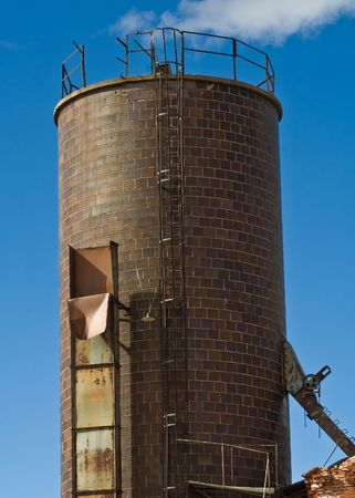 A brick tower for an abandoned electric plant in Walsenburg, Colorado with a very blue sky.
