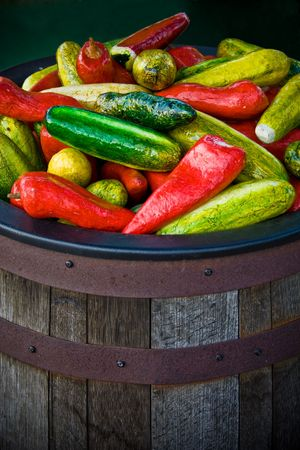 Large wooden barrel of fake peppers in front of a store in Old Town, San Diego, California