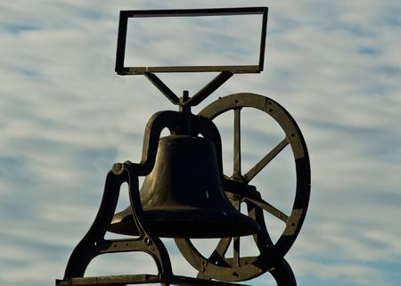 An old bell mounted on a store in Old Town San Diego, California