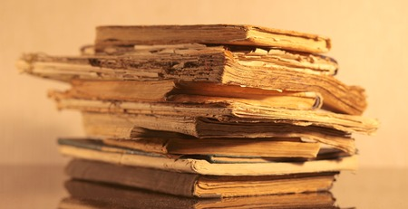 yellowed: A stack of old yellowed books closeup