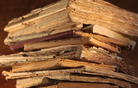 medios de comunicacion: A stack of old yellowed books closeup