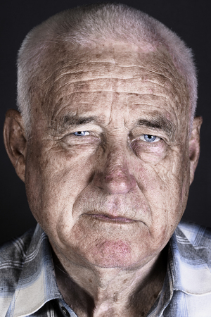 upset man: Stylized portrait of an old man on a black background Stock Photo