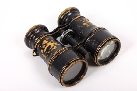 antique binoculars: Antique vintage binoculars isolated on a white background