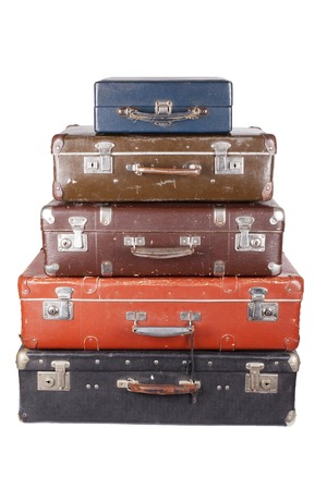 suitcase: A stack of old suitcases isolated on a white background