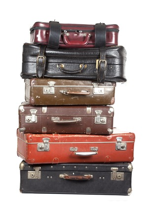 antique suitcase: A stack of old suitcases isolated on a white background