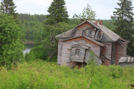 rickety: Old rotten rickety wooden house in North Russia