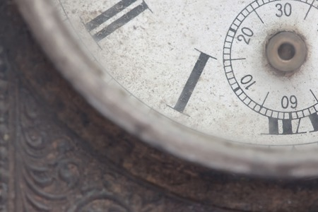 A fragment of the dial of the old clock close up