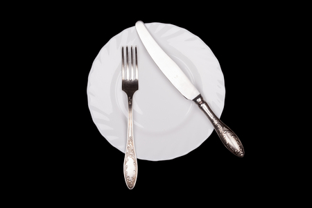 etiquette: Etiquette sign. Plate, fork, knife top view isolated on black background Stock Photo