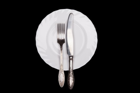 sign plate: Etiquette sign. Plate, fork, knife top view isolated on black background Stock Photo