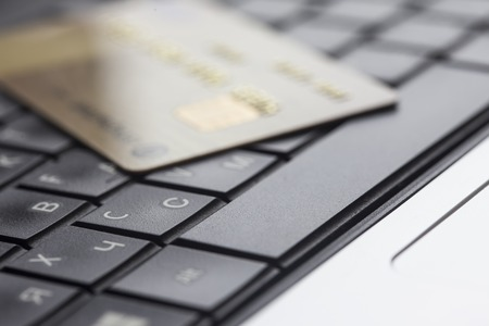 secure shopping: Bank card on computer keyboard close up Stock Photo