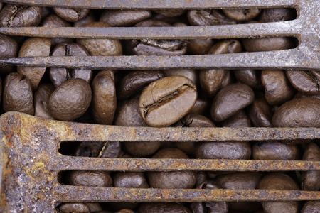 grunge cutlery: Roasted grains of coffee and old forks background closeup