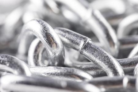 catenation: new luminous silver chain pile close up