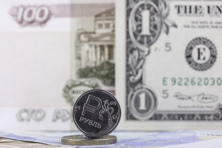 savings and loan crisis: euro coin on the background of the banknote 5000 rubles close up