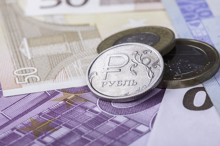 coin ruble against the background of Euro banknotes closeup Imagens