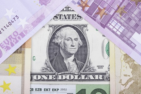 economic rent: banknotes of Euro and usa dollar in the form of the house
